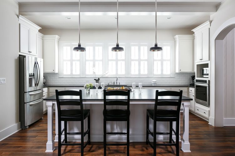Black and white kitchen with large honed black leathered