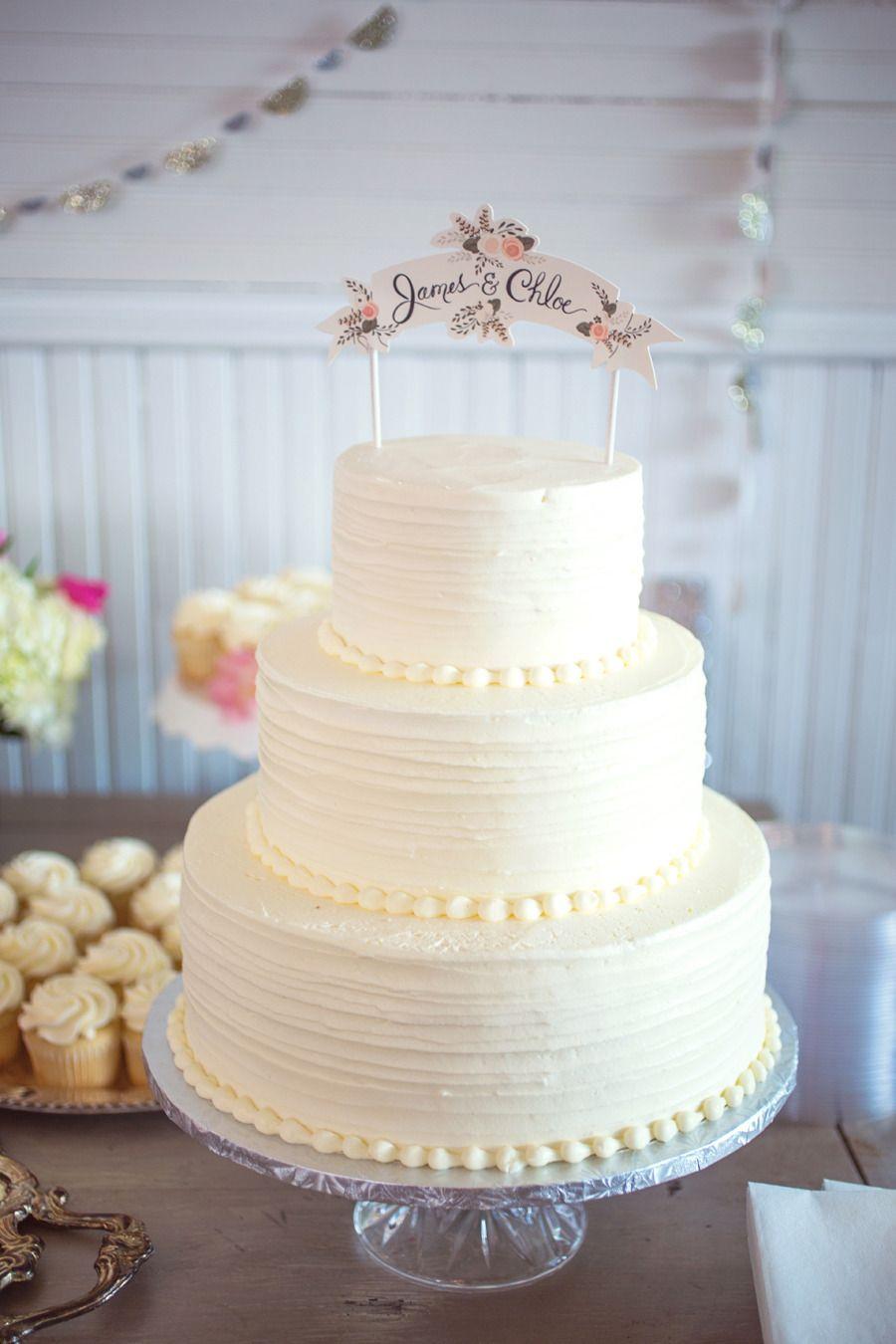 Simple, white, three tier wedding cake