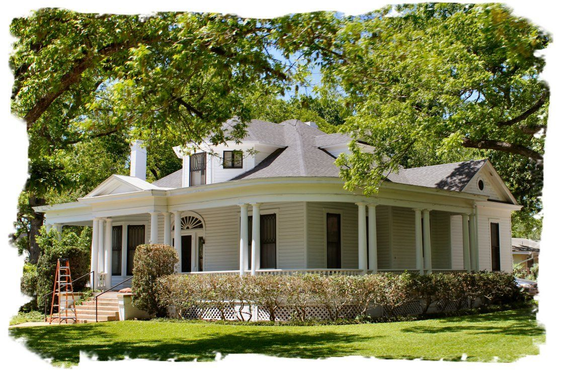 Image of one story farmhouse with wrap around porch