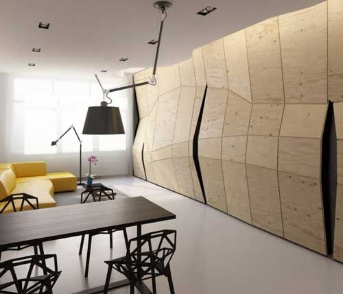 Transformer Apartment- Plywood wall panels open, pivot, swing and fold to reveal functional spaces, storage and built-in furniture.