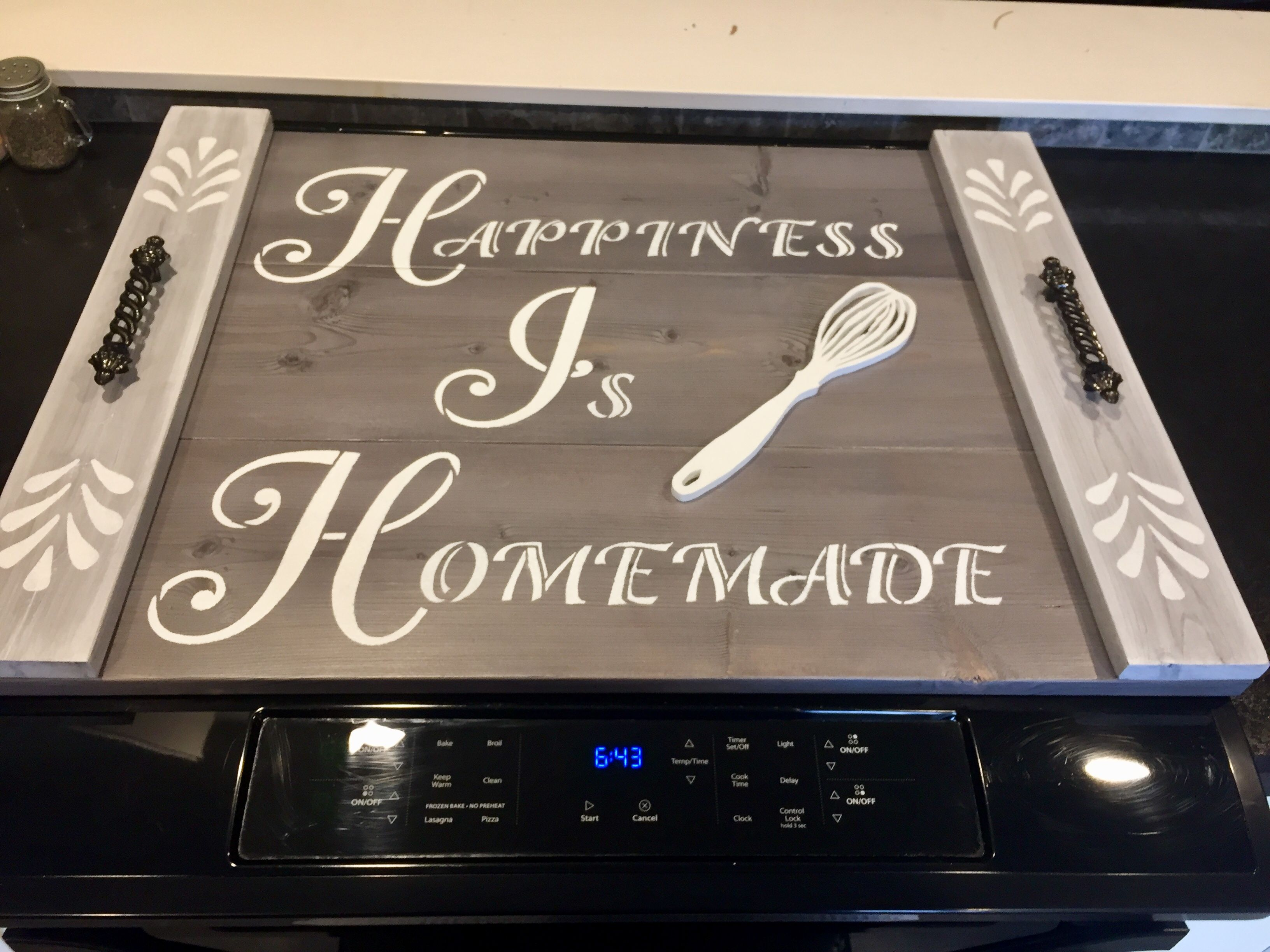 Grey stained with white wash, white stenciling, scroll