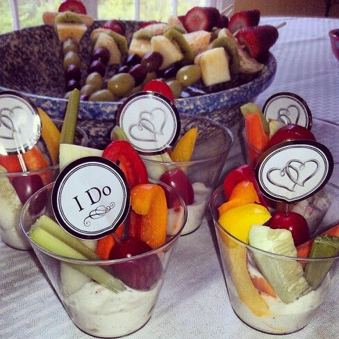 Vegetable cups with my own little twist with the I do's and hearts and fruit kabobs! Perfect bridal shower foods