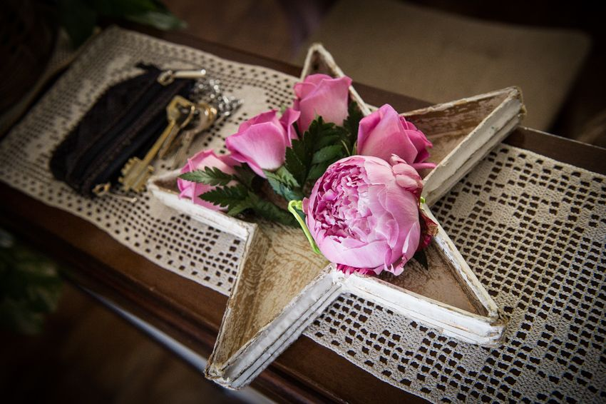 Boutonniere with pink roses. Pink peony corsage for maid of honor.