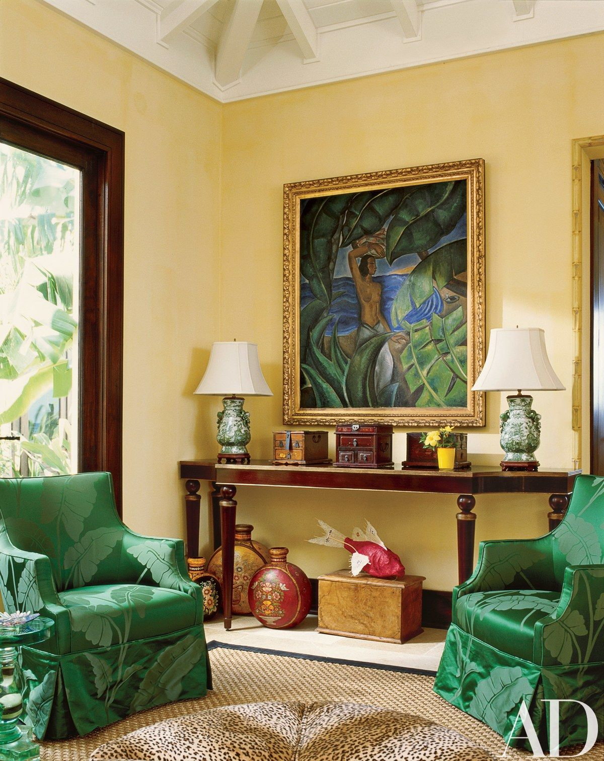 A palette of yellow ocher and green prevails in the living room, as ...