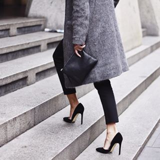 street chic - black heels, pants and clutch bags