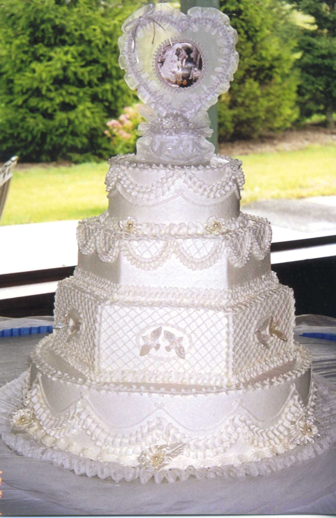Other / Mixed Shaped Wedding Cakes - Wedding cake iced and accented ...