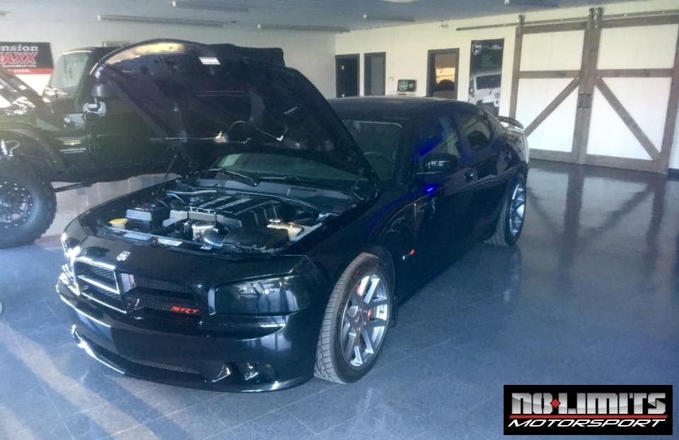 2010 dodge charger srt8 with an edelbrock supercharger the 2010 dodge charger srt8 with an edelbrock supercharger the supercharger increased the horsepower from 425hp sciox Choice Image