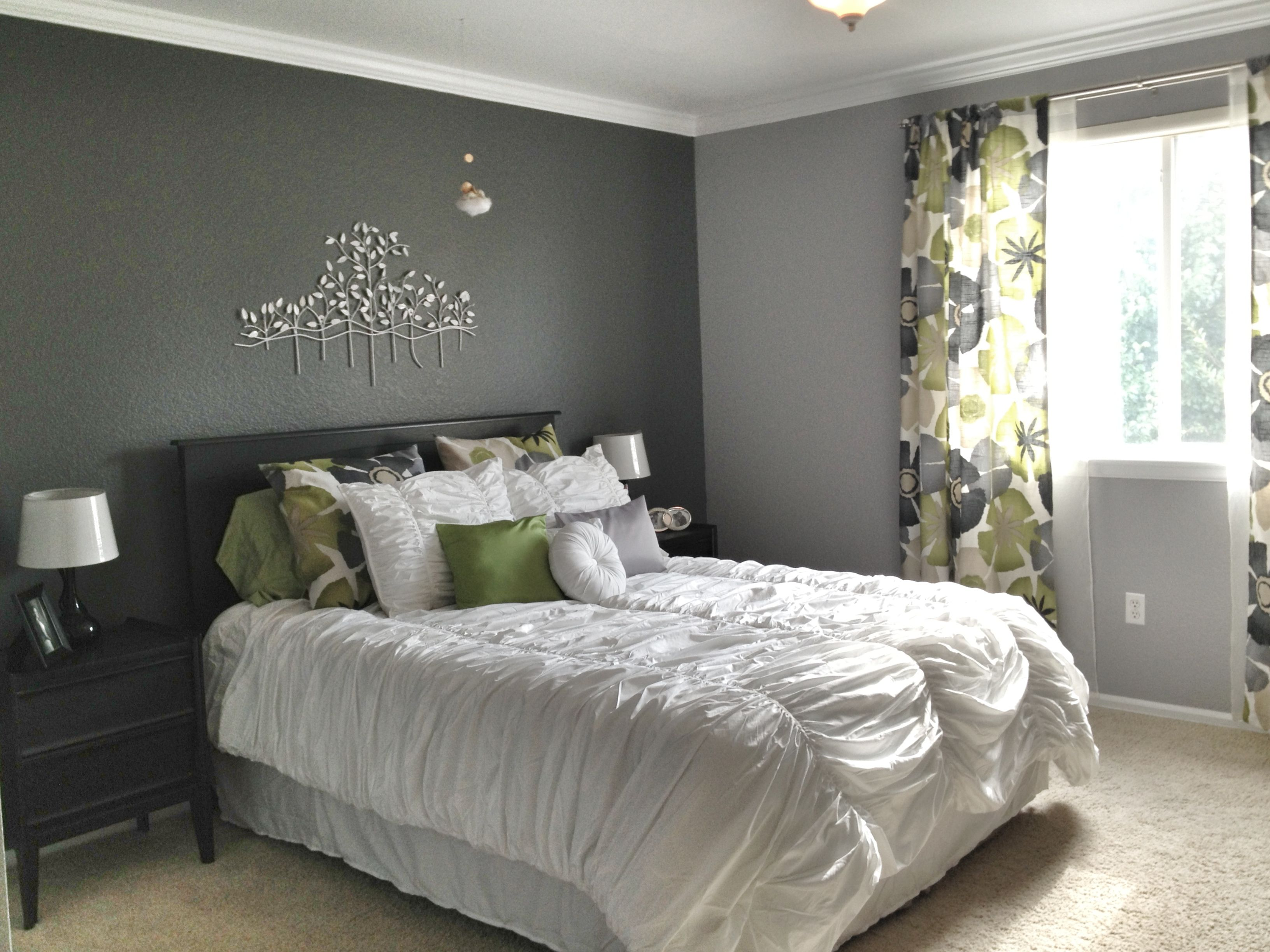 Grey master bedroom dark accent wall fun patterned curtains with matching shams and bright white bedding