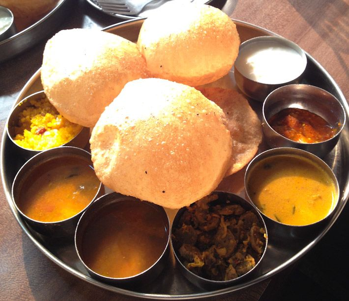 Incredibly complete South Indian Tali: with different vegetable preparations, daal (lentils), yogurt, pickles, puri, papadam and sweet dish