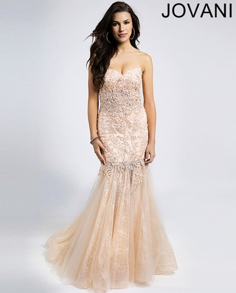 Beaded lace appliques coat the bodice of jovani prom dress