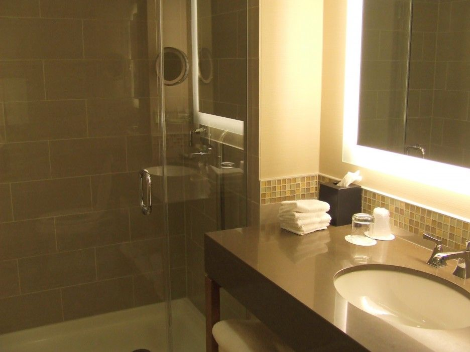 Great Beautiful Small Bathrooms Finished With Frameless Mirror ...