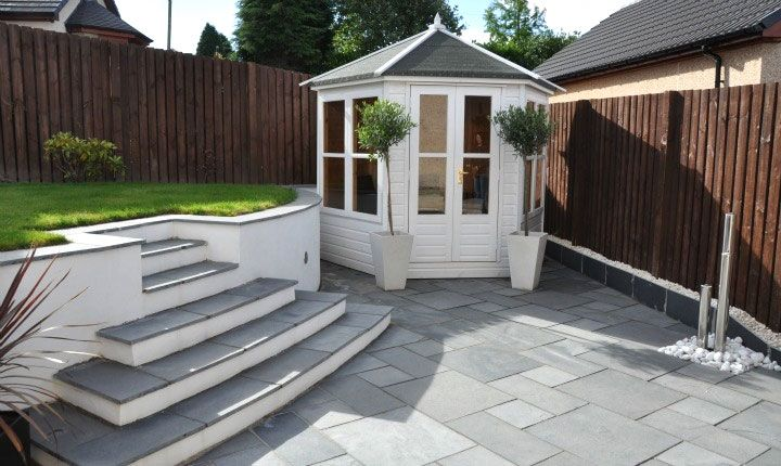 Black Limestone Patio And Steps Leading To Lawn Area