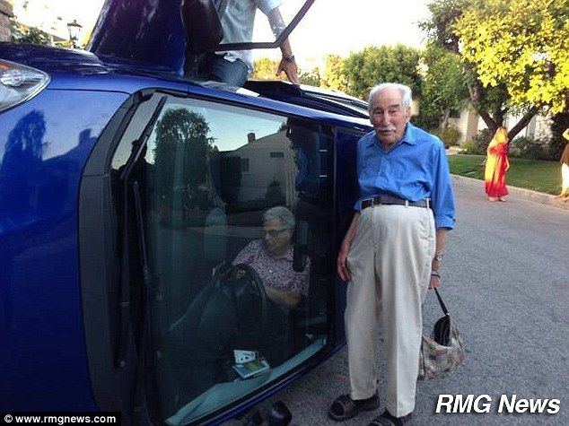 It's the crash prince of Bel Air! Octogenarian and his wife of 60 years flip over their car in wealthy LA enclave and POSE up for photos