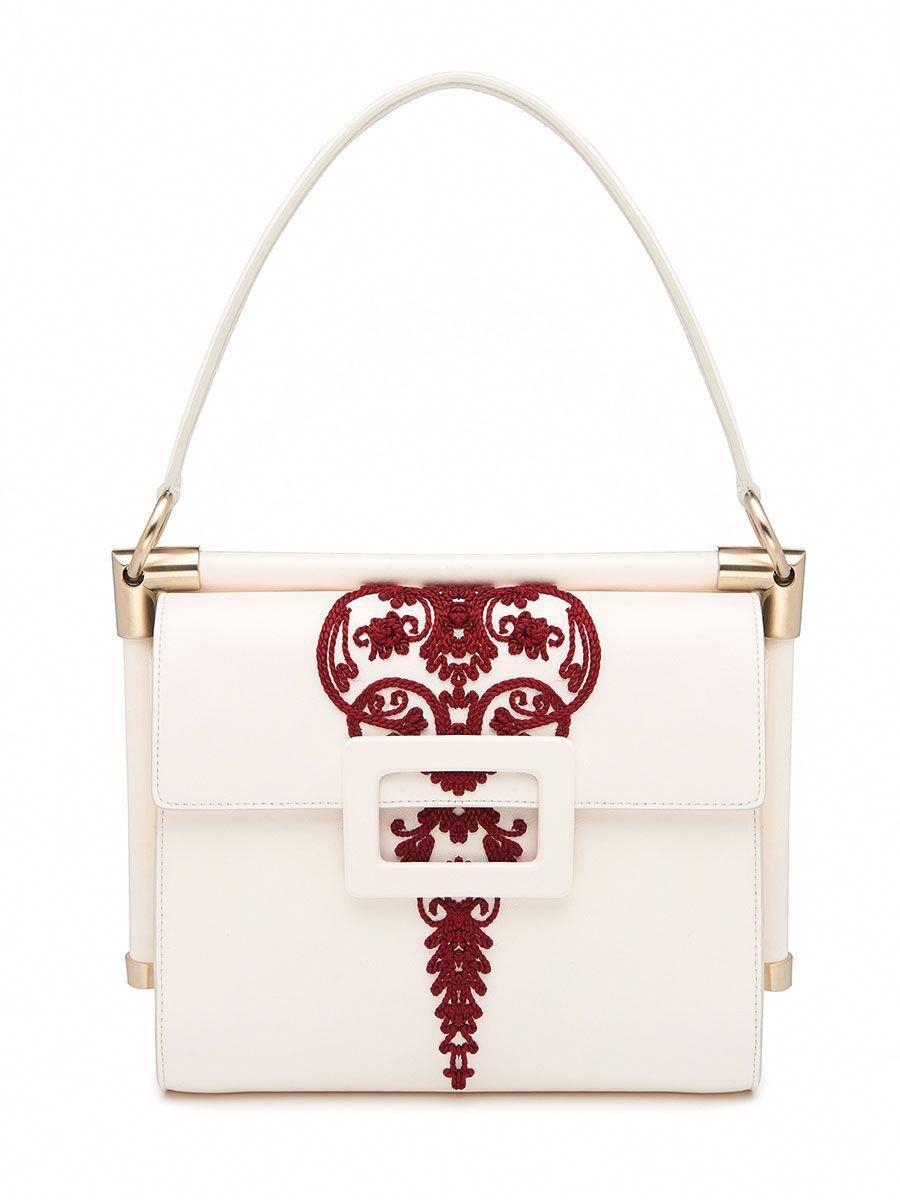 Inès de la Fressange s Chic New Bags for Roger Vivier Have a Bit of  Wanderlust – 8d8b8435b9