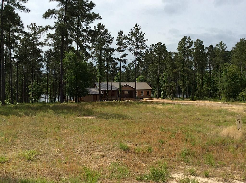 Custom designed, 1,810 sqft* 3 bedroom / 2 bath waterfront home situated on a generous 1.45** acre lot with mature trees. *=Per Builder **=Per Survey