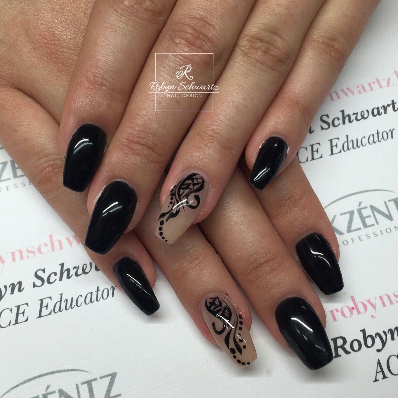 Black and nude coffin gel nails with hand painted swirls