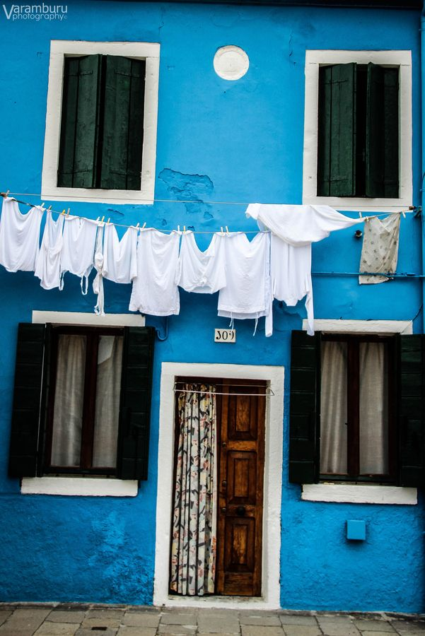 Blue house and white clothes by Vanessa Aramburu, via 500px