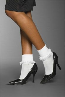 A blonde wearing white ankle socks and high heels does