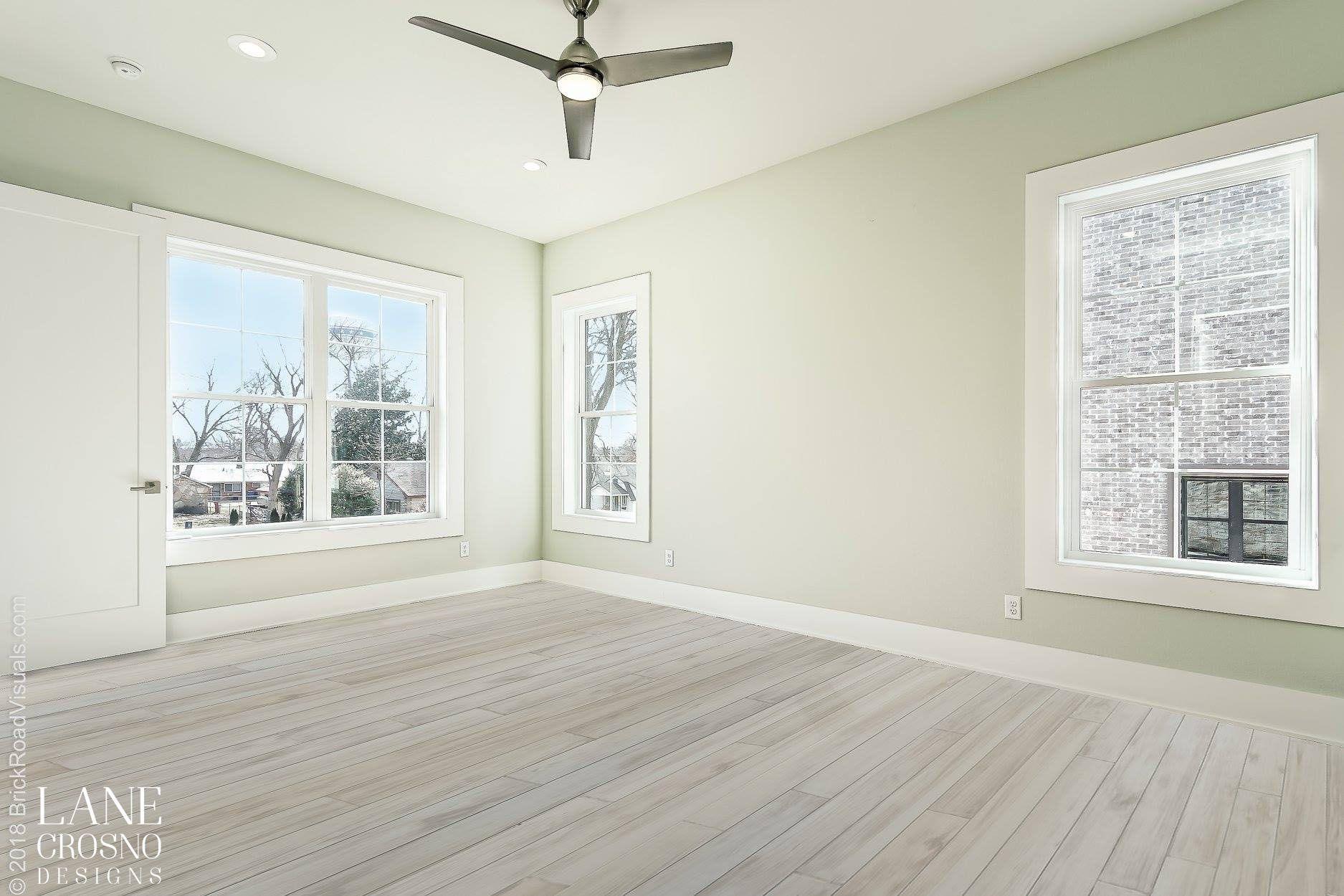 Master Bedroom With Wood Look Tile Floors Natural Light Lots Of Windows Gray Walls Modern Fan Wood Look Tile Floor House Design Wood Look Tile
