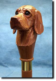 Vizsla Dog Walking Stick. The Vizsla Dog Walking Stick is a reproduction of an original woodcarving by Michael Park, a Master woodcarver, recognized worldwide for his detailed carvings and reproductions. Michael's passion and love for dogs are evident in his outstanding workmanship.