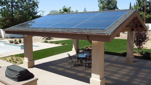 Solar panels do double duty as patio roof | Proud Green Home - Solar Panels Do Double Duty As Patio Roof Proud Green Home