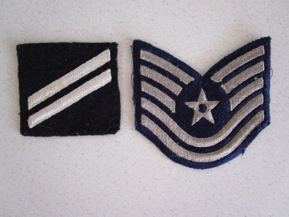 A US aviation patch with Star and Bar Design. I think it is from World War II. And another patch that is black and white that I cannot find information on.   Measurements:  Star Patch: 3 3/4 inches x 3 1/2 inches tall Black and White: about 3 x 3 inches.