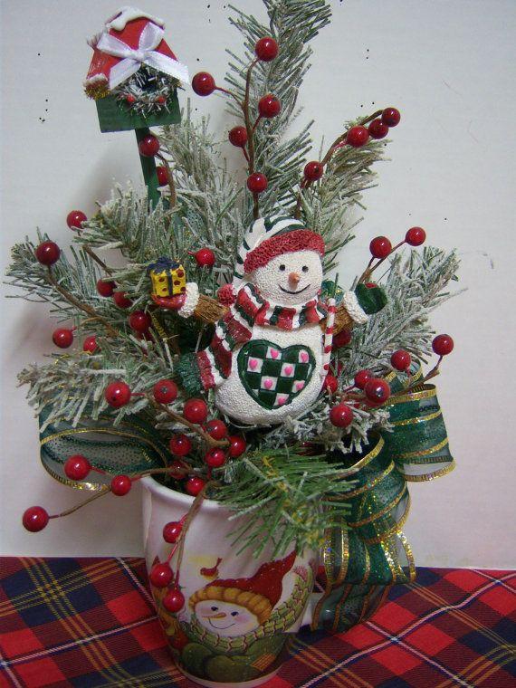 Snowman theme christmas floral arrangement in holiday mug