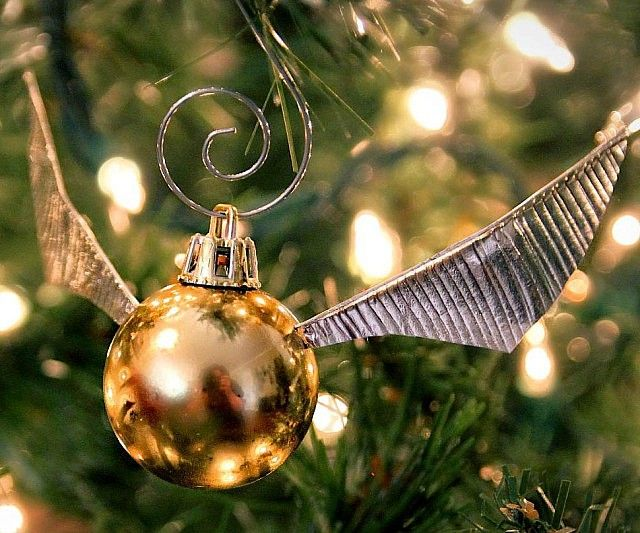 Give your muggle tree a magical touch by accenting it using some DIY golden snitch ornaments. This easy to follow guide provides detailed instructions so that you can turn any regular ornament into your very own custom crafted snitch.