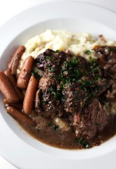 Red Wine Braised Beef with Carrots, Onion, and Garlic | Easy one-pot meal that is downright comfort food.