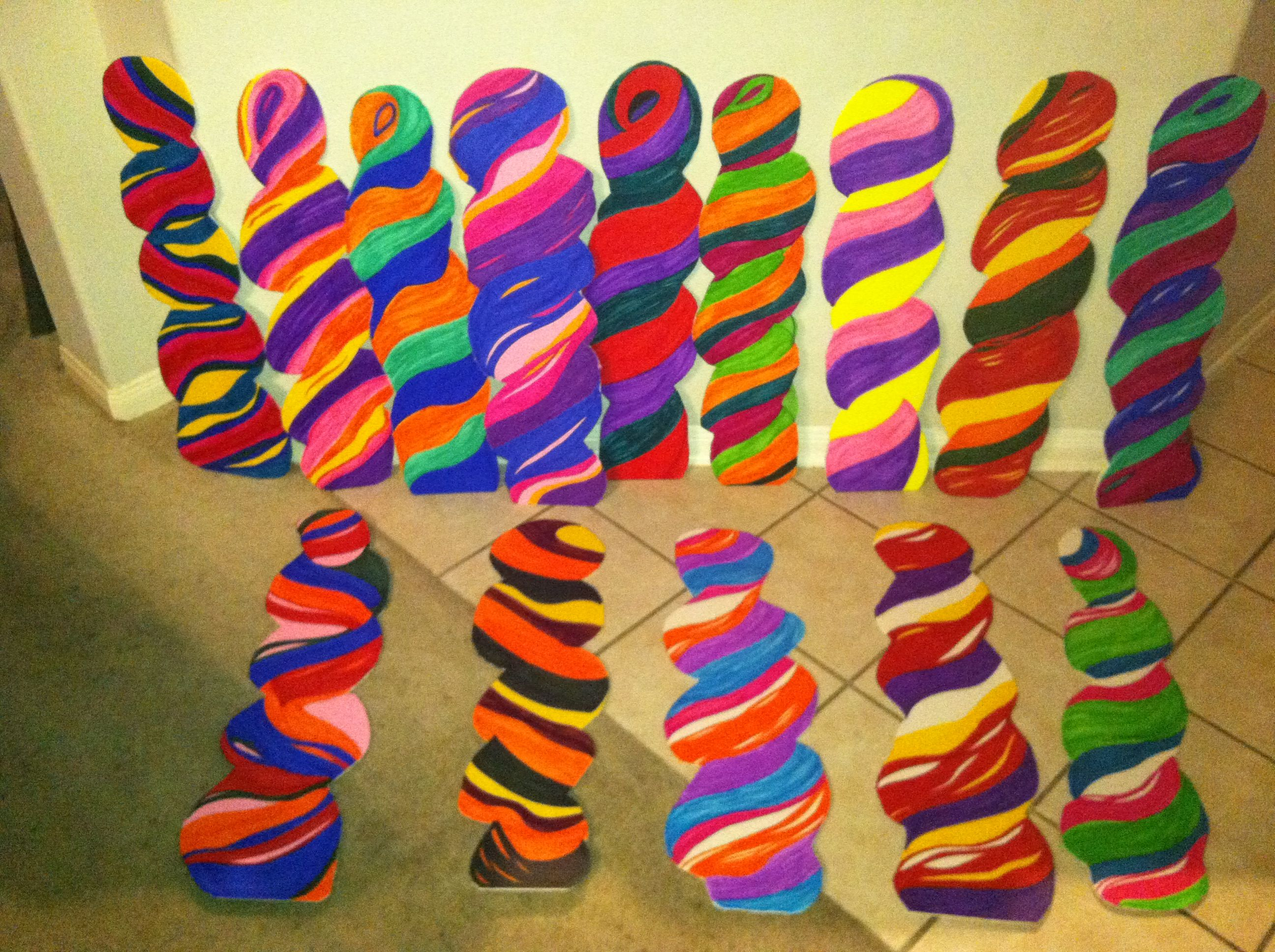Cardboard lollipops cutouts, colored with markers on foam board then placed on 4 ft sticks for Willy Wonka, Candyland, Lollipop party event or decorations. We did a Willy Wonka Wedding May 2013 www.leshadesigns.com