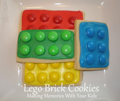 Lego sugar cookies.  Pipe frosting around the edges then fill in.  M&Ms
