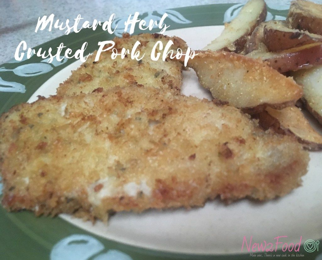 Boneless pork chops brushed with a herbs and mustard and coated with panko breadcrumbs and parmesan.  Lightly fried and baked to a golden perfection.