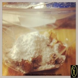 Add extra powdered sugar on top of the cookies and carefully mix to coat them.