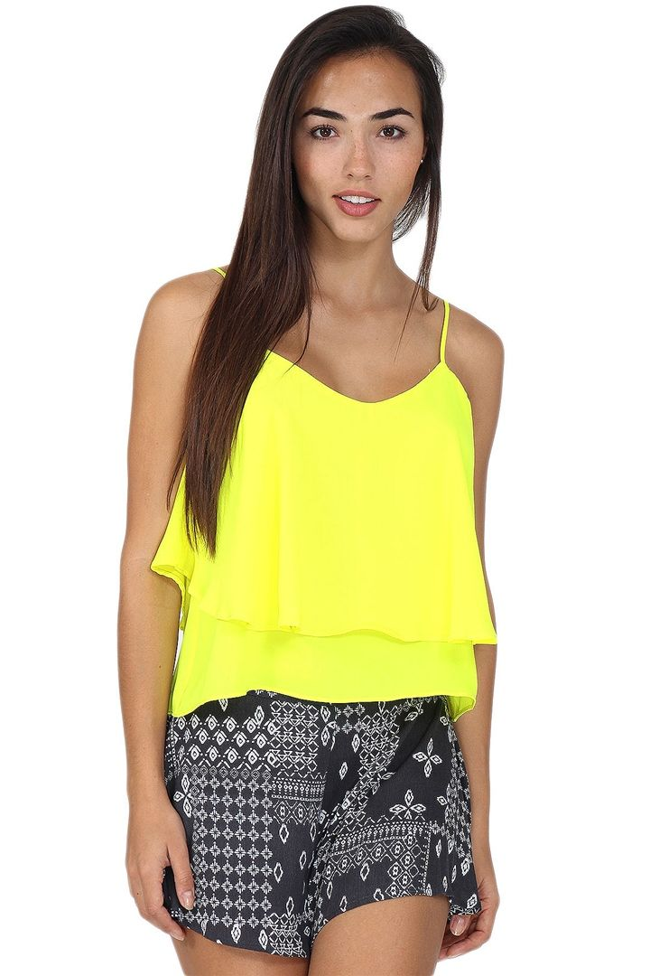 246acc3c66167 Neon yellow flowy spaghetti strap tank with buttonhole closure on the back.  This tank goes great with palazzo pants or printed shorts for a fun and chic  ...