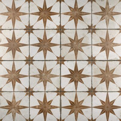 null It's official: These tiles will have your guests seeing stars. Sorry, we couldn't help ourselves to the pun – we're just obsessed with these tiles and their starburst pattern. They're crafted in Spain from ceramic, and feature a gray starburst design with a distressed finish for some serious vintage vibes. They're rated for heavy light traffic and are water-resistant, meaning you can use them everywhere from your kitchen backsplash to your shower floor. Each tile measures 17.63'' square, an