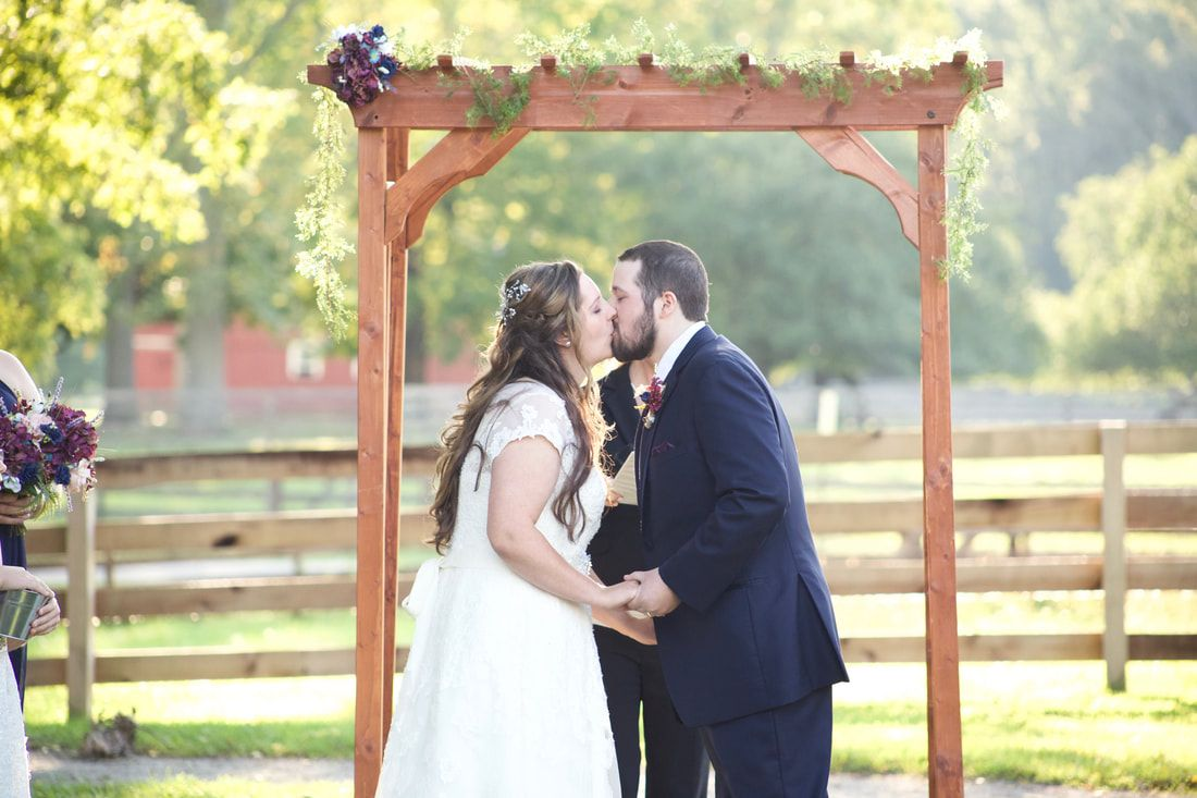 Bride and groom share their first kiss