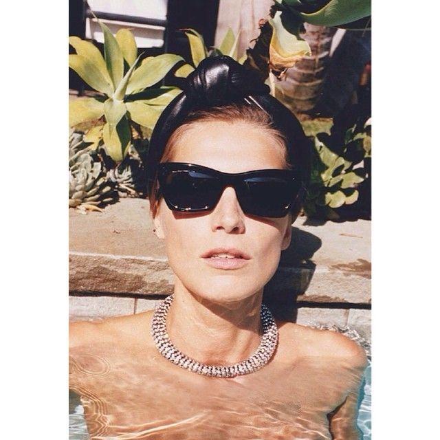 Too-cool-for-the-pool #DariaWerbowy in a #Celine crystal choker. #PoolsAndJewels #TheStoneSet