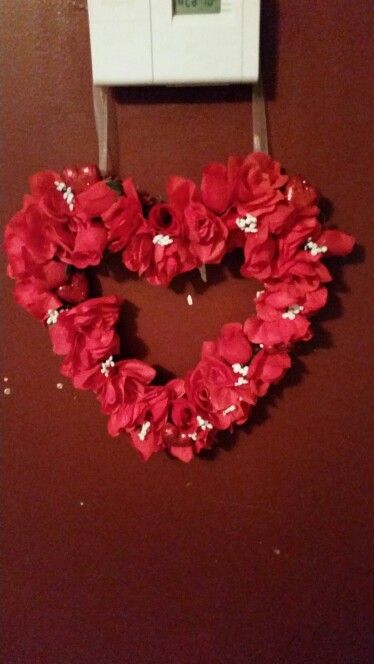 Valentines wreath. Started with dollar store heart and 5 or 6 rose bundles. And presto! A beautiful  wreath