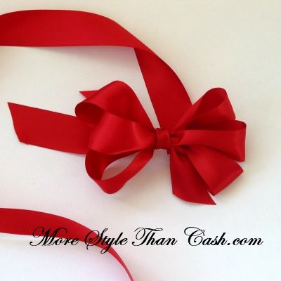 Tying a bow on a present once you learn how to make a florist gift negle Images