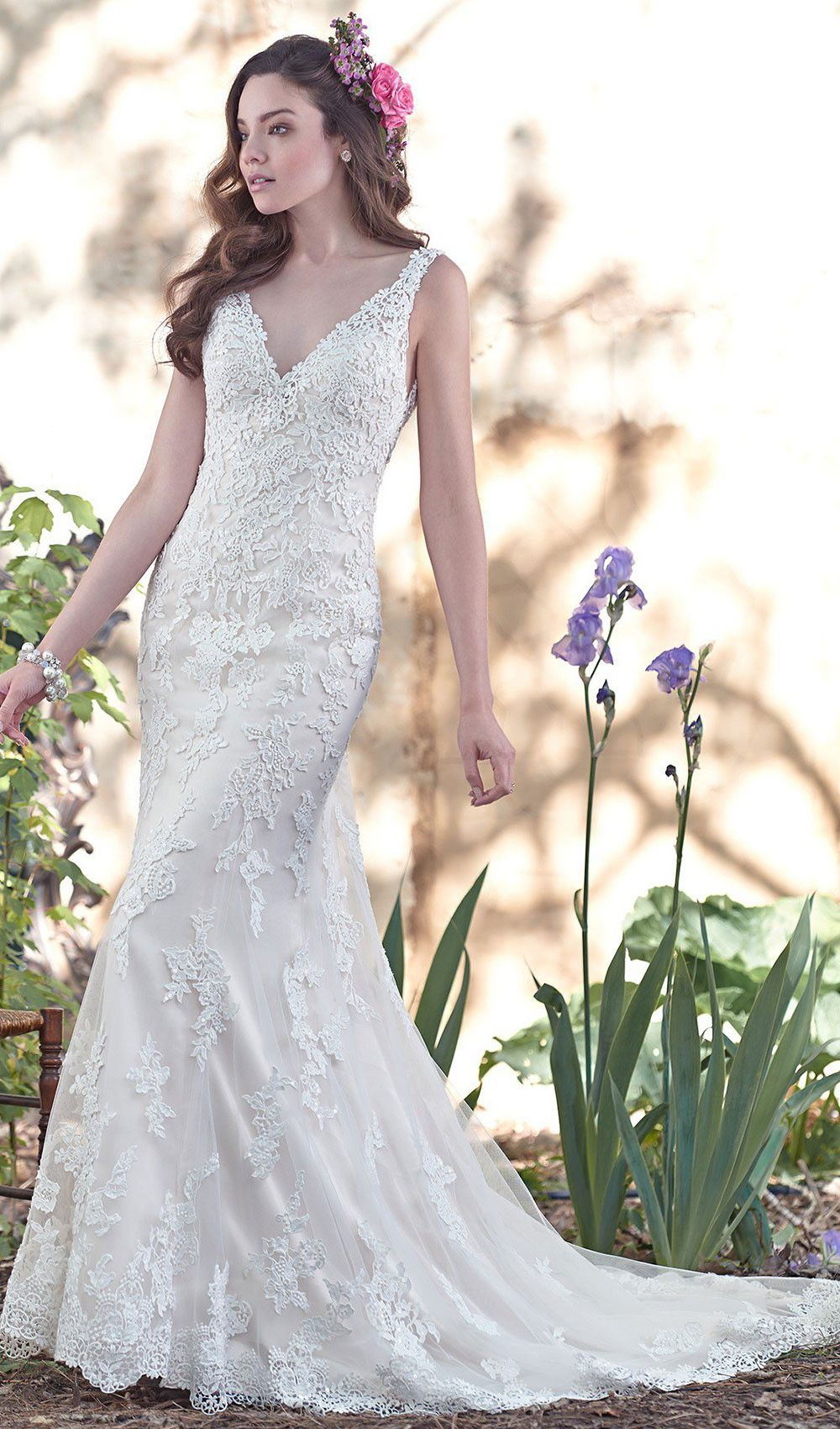Try this tulle wedding dress with deep vneckline and stunning