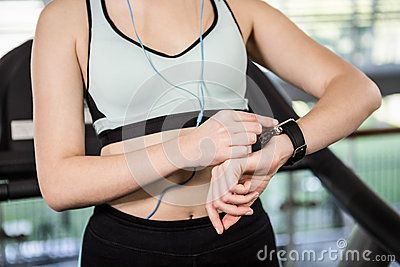 Active Woman Using Smartwatch Stock Photo - Image: 60895414