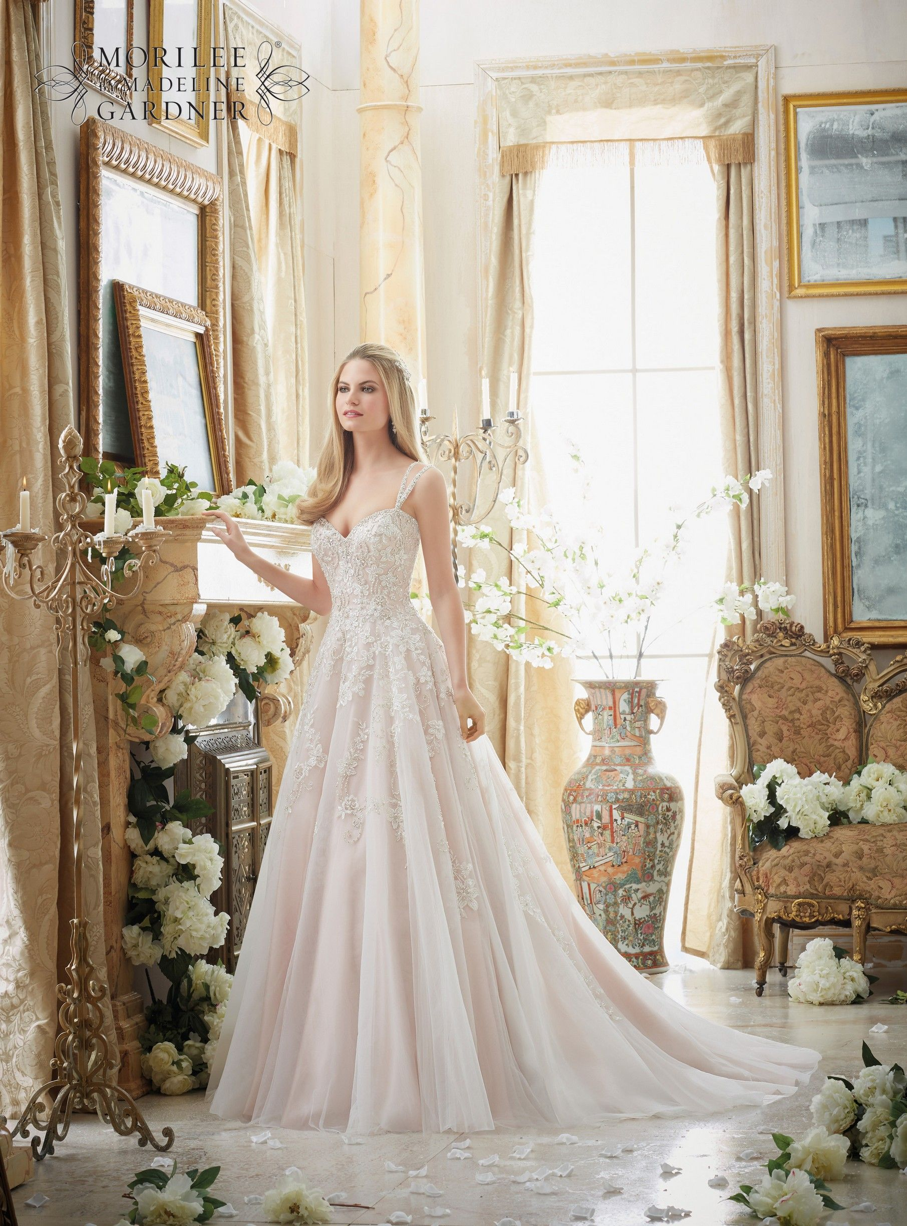 Back detail wedding dress  A soft tulle Aline dress with elaborately beaded embroidery The