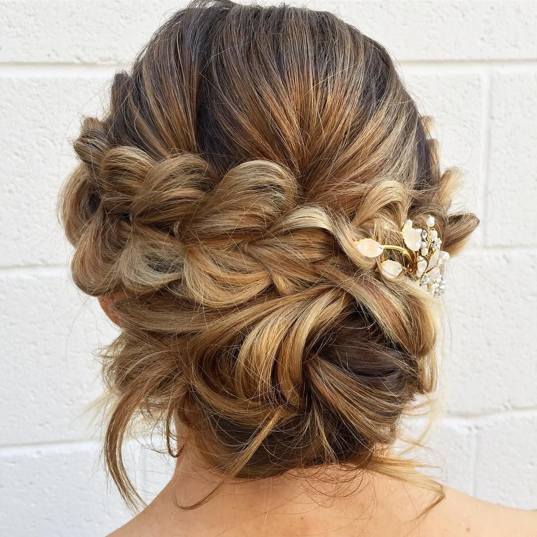 pull-through-braid with a low messy bun in the back,updo