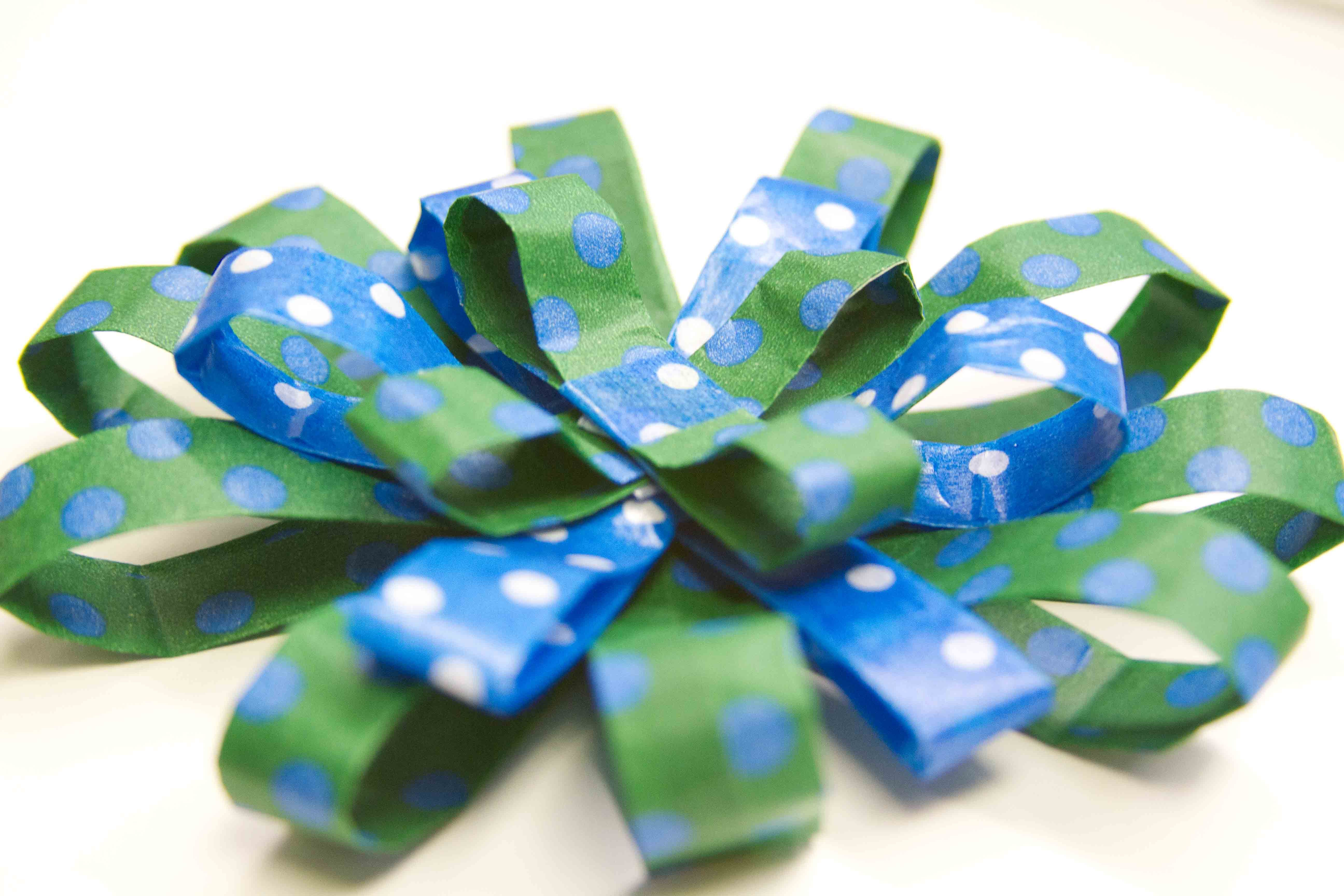 Here is a bow made from Snazzy tape by Mavalus. It works great on gifts!