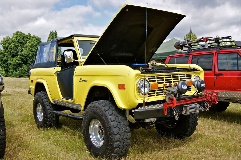 Yellow Ford Bronco Sports Utility Vehicles hood open (With
