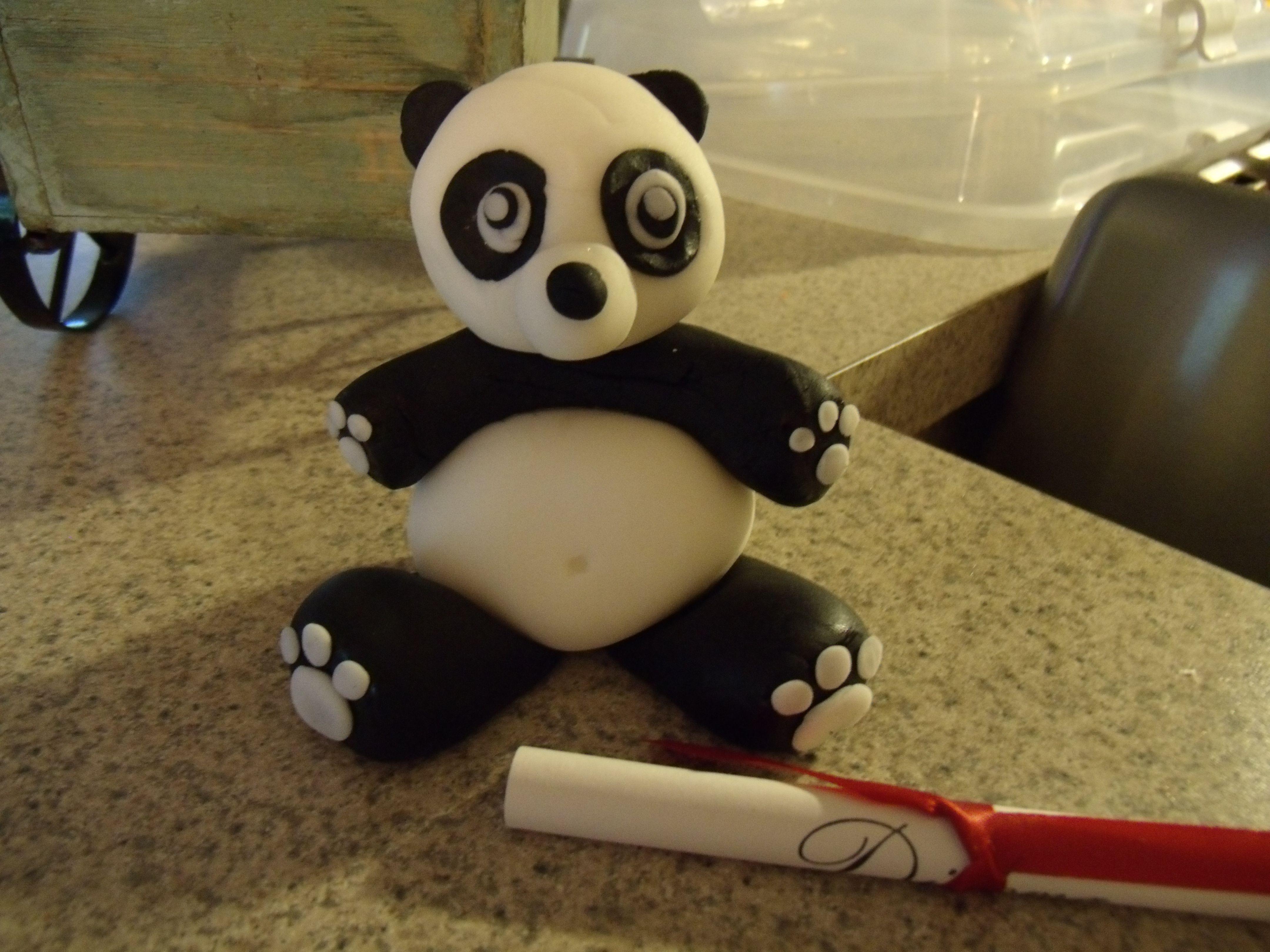 Panda Bear cake topper made out of fondant Fondant