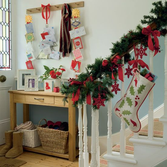Decoration Ideas For Christmas love the use of the stair rails to hang the stockings on for decor