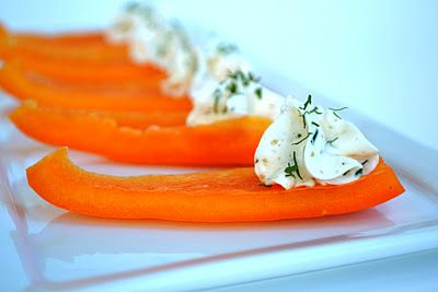 Flavored cream cheese piped onto vegetable strips. Easy and elegant