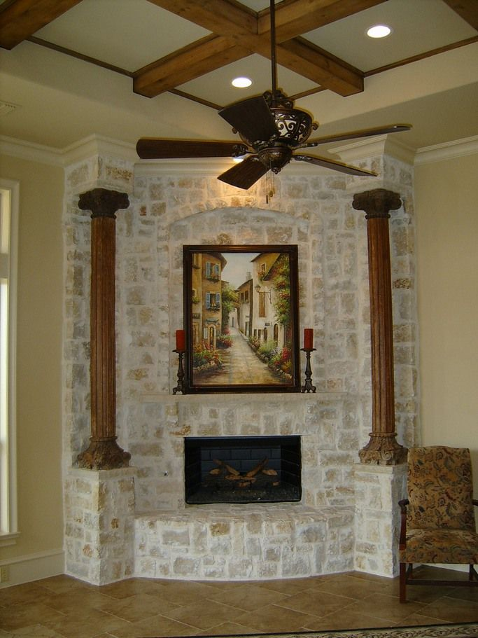 Corner stone fireplace accent wall with pillars house Corner rock fireplace designs