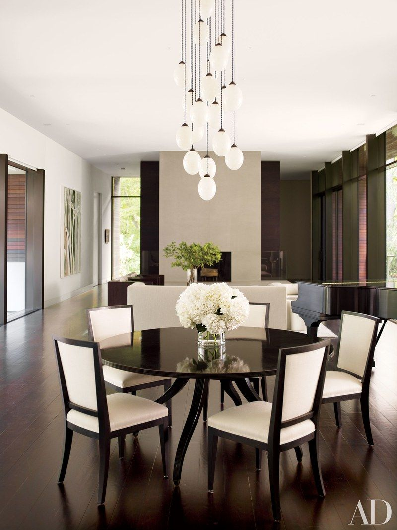 10 Photos That Prove Blackandwhite Interiors Are Timeless Entrancing Dining Room Light Fixtures Traditional Inspiration